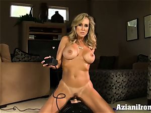 Brandi enjoy rides the sybian saddle naked