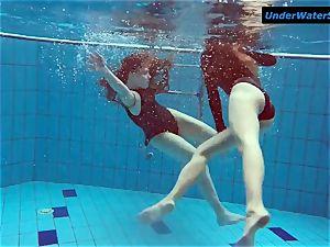 two warm teens underwater