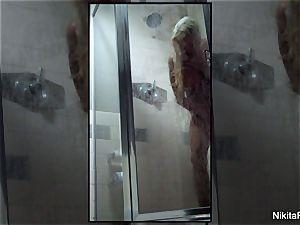 Home flick of Nikita Von James taking a bathroom