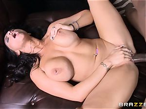 Romi Rain tears up her scorching ebony trainer in front of her fellow