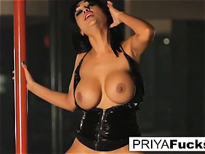 buxom Priya Rai rides the sybian saddle at the de-robe club